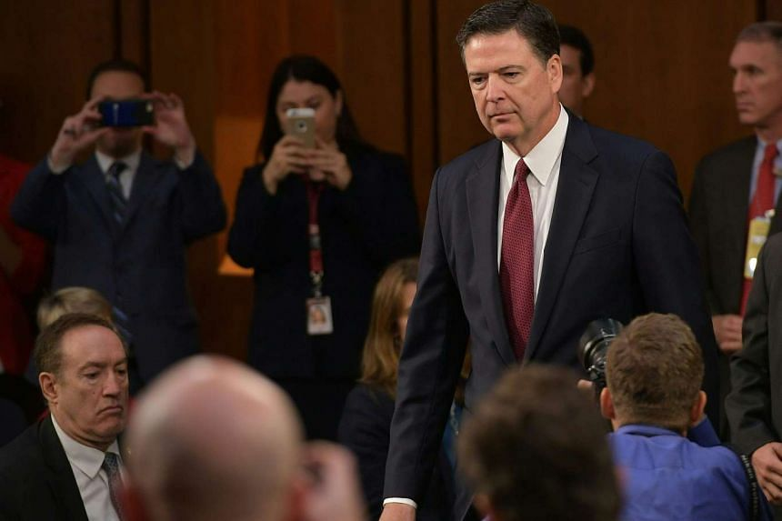 James Comey arrives to testify.