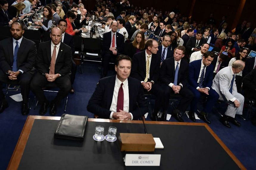 Comey waiting to testify.