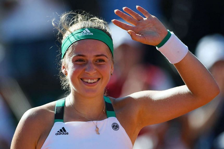 Jelena Ostapenko celebrates winning on her 20th birthday.