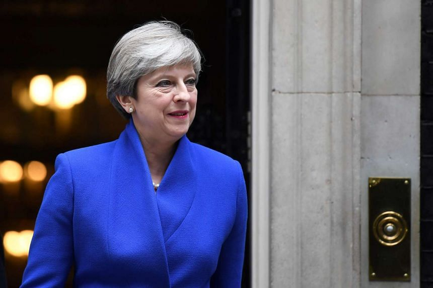 Britain's Prime Minister and leader of the Conservative Party Theresa May leaves 10 Downing Street in central London on June 9, 2017