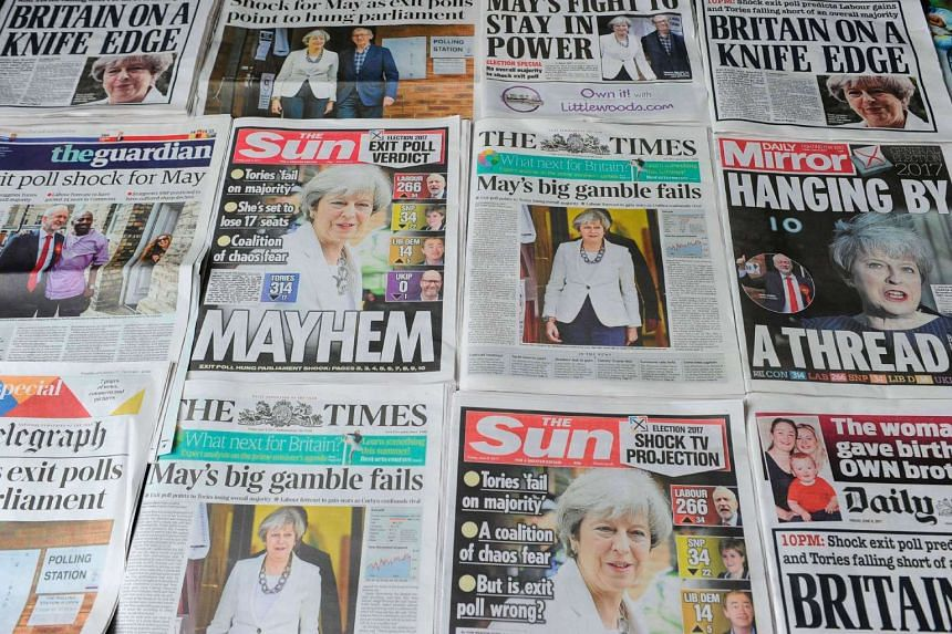 An arrangement of British daily newspapers on June 9, 2017 showing front page stories about the exit poll results of the snap general election.