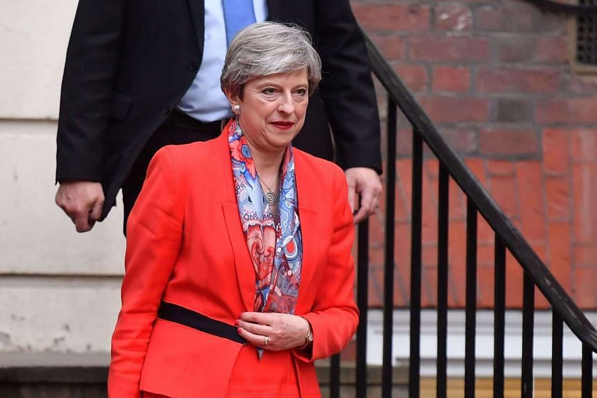 British Prime Minister Theresa May leaves the Conservative Party headquarters in central London, on June 9, 2017.