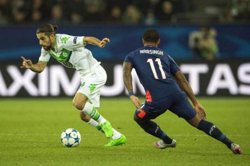 PSV Eindhoven's forward Luciano Narsingh (right) and Wolfsburg's Swiss defender Ricardo Rodriguez vie for the ball during the Group B, first-leg UEFA Champions League football match in Wolfsburg, northern Germany on Oct 21, 2015.