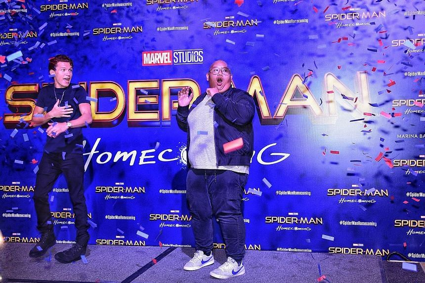 Actors Tom Holland (far left) and Jacob Batalon at the red carpet event for Spider-Man: Homecoming at the ArtScience Museum.