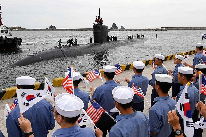 Professor Yang Moo Jin of the University of North Korean Studies said the latest missile test may be Pyongyang's way of expressing displeasure over the arrival of the 6,900-ton USS Cheyenne submarine (above) in the South Korean port of Busan on Tuesd