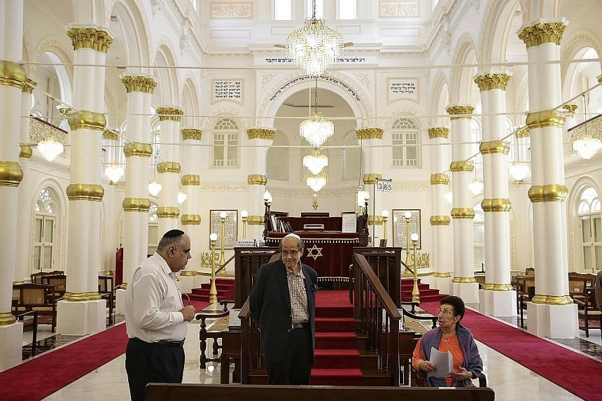 The Chesed-El Synagogue will have its maintenance and restoration works co-funded this year. In the synagogue's prayer hall are (from far left) Mr Sol Solomon, who provides administrative support to Chesed-El; Mr Sam Sassoon, chairman of the board of