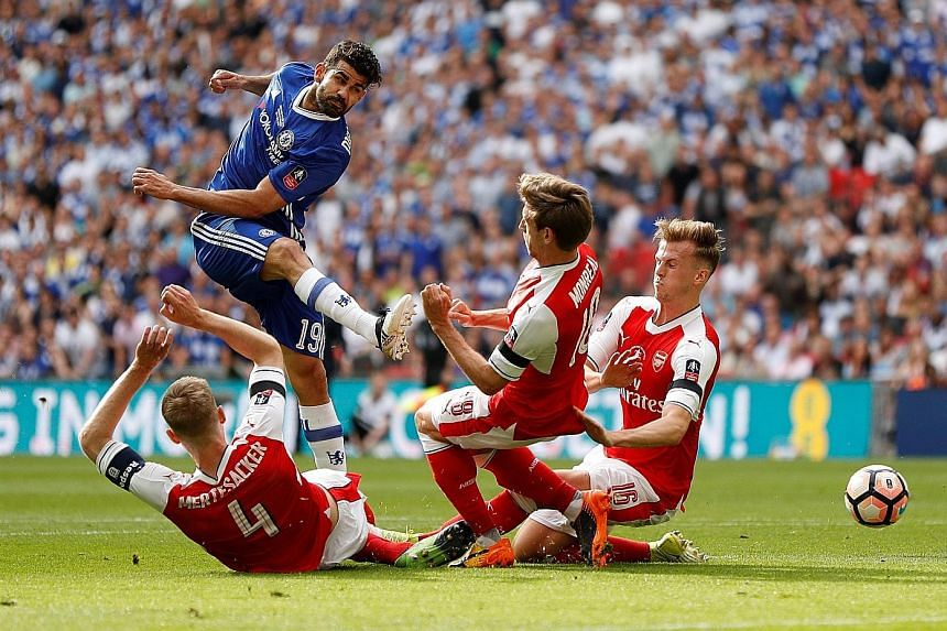 Chelsea's Diego Costa finds a gap between the Arsenal trio of Per Mertesacker, Nacho Monreal and Rob Holding. His 22 goals played a major role in Chelsea's victory in the English Premier League.