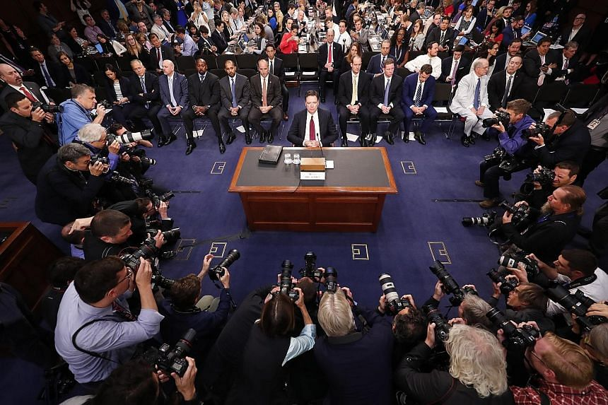 Former FBI director James Comey preparing to testify before the Senate Intelligence Committee in Washington yesterday. He was expected to provide details about a probe into Russian meddling in the 2016 election.
