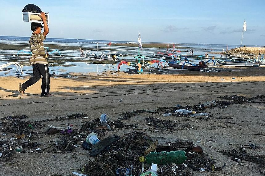 Plastic bottles, containers and other debris washed up on Sanur beach in Bali, Indonesia. About eight million tonnes of plastics are said to enter the world's oceans every year, clogging reefs and coastlines, and killing marine life.