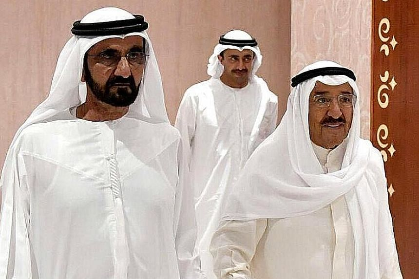 Sheikh Mohammed bin Rashid Al Maktoum (far left), UAE's Vice-President, Prime Minister and Ruler of Dubai, receiving Sheikh Sabah Al-Ahmad Al-Sabah, the Emir of Kuwait, in Dubai on Wednesday. The Kuwaiti Emir is mediating in the crisis between Qatar