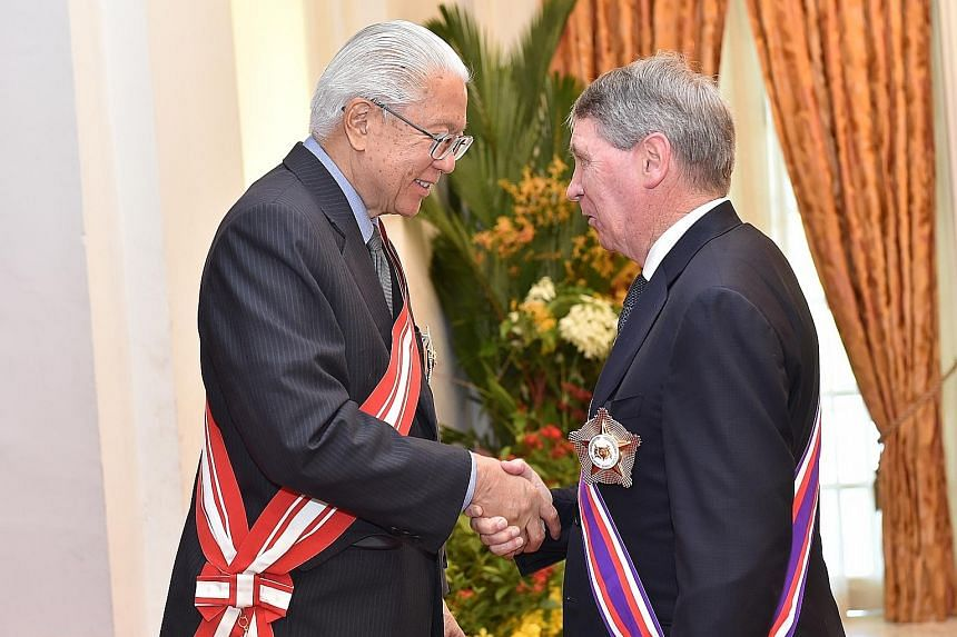 Former Australian secretary of defence Dennis James Richardson received Singapore's highest military award, the Darjah Utama Bakti Cemerlang (Tentera), at the Istana yesterday. President Tony Tan Keng Yam presented him with the award, also known as t
