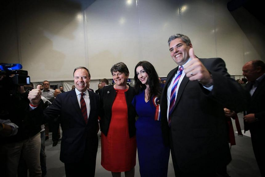Democratic Unionist Party (DUP) leader Arlene Foster (second from left), joins her three returning MP's at the Belfast count centre.
