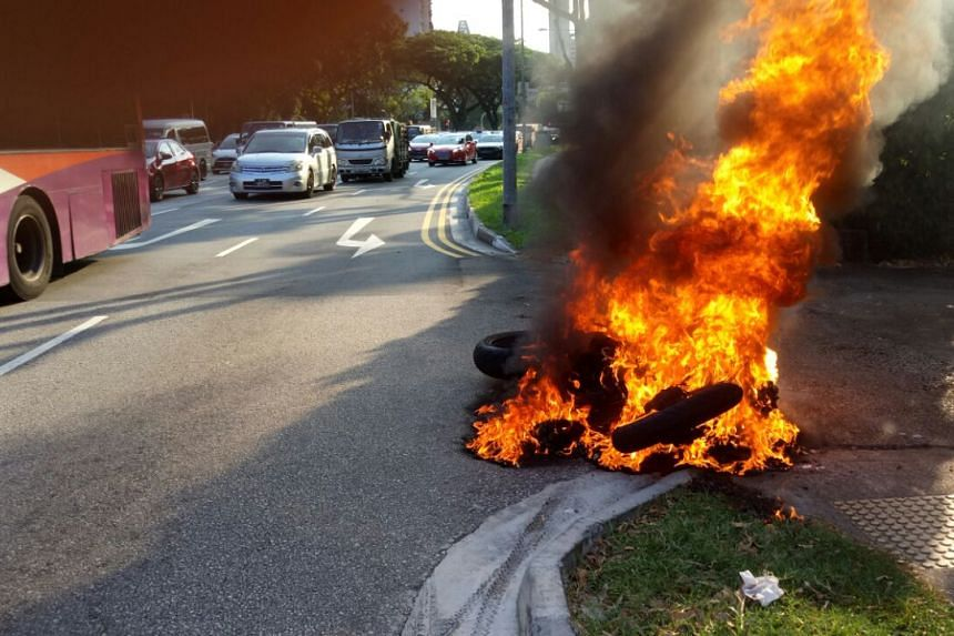 A motorcycle caught fire along Moulmein Road on June 9, 2017.