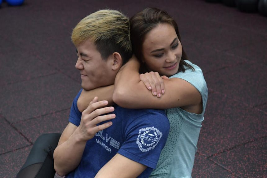 UFC strawweight fighter Michelle Waterson demonstrating a rear-naked choke.