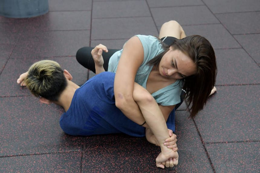 UFC strawweight fighter Michelle Waterson demonstrating a kimura.