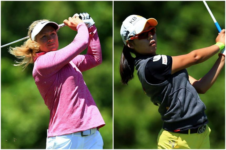 Suzann Pettersen (left) shrugged off the loss of her yardage book to surge into a share of the lead with Lee Mi Hyang.