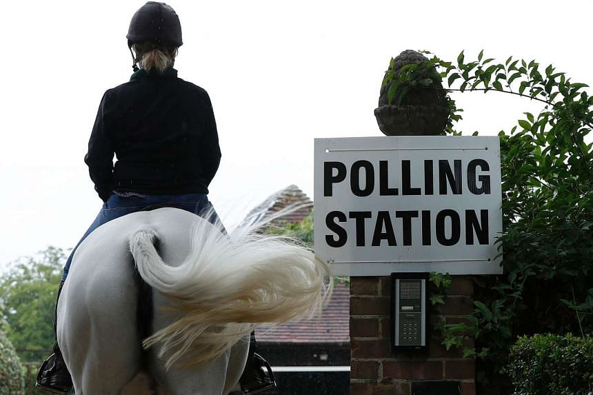 Sophie Allison, riding her horse Splash, returns to the driveway of a private residence, set up as a Polling Station.