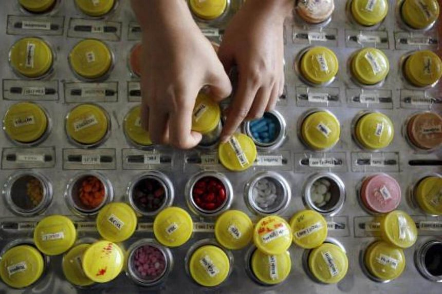 A nurse preparing doses of HIV-AIDS drugs for patients.