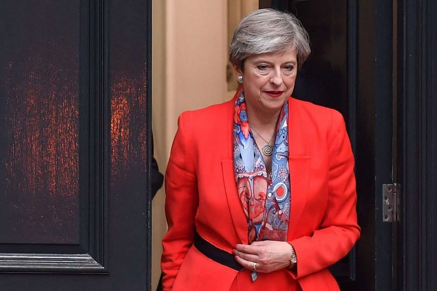 British Prime Minister Theresa May leaves the Conservative Party HQ in central London, on June 9, 2017.