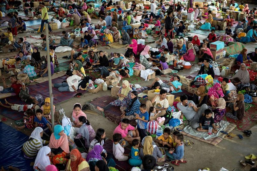 Evacuees from Marawi City camp rest at the Saguiaran Townhall in Lanao del Sur on June 5, 2017.