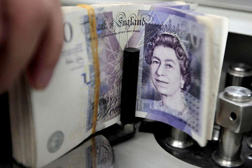 Pound notes being counted in a bank.