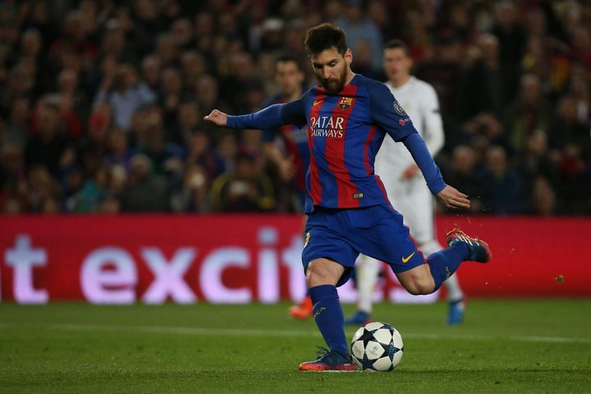 Barcelona's Lionel Messi scores his third goal from the penalty spot during a match between Barcelona and Paris St Germain in UEFA Champions League Round of 16 Second Leg.