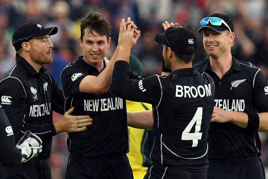 New Zealand Adam Milne (second from left) celebrates, with teammates during the ICC Champions Trophy match between Australia and New Zealand on June 2, 2017.