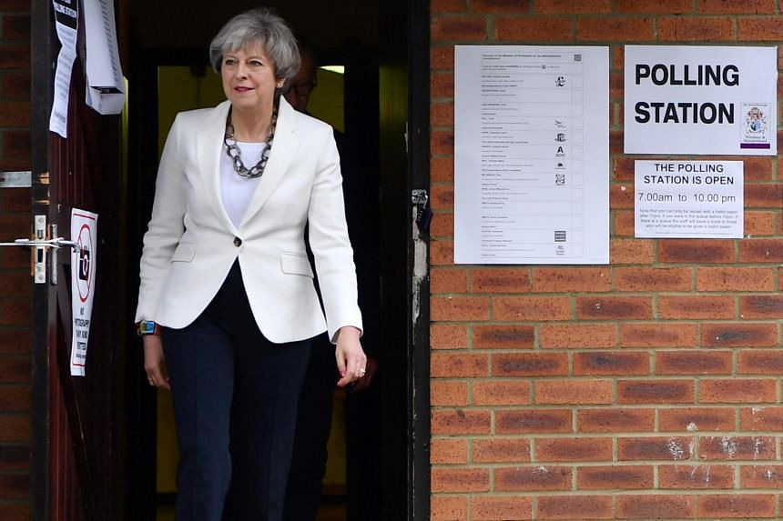 Britain's Prime Minister Theresa May leaves a polling station after casting her ballot paper in Sonning, west of London, on June 8, 2017.