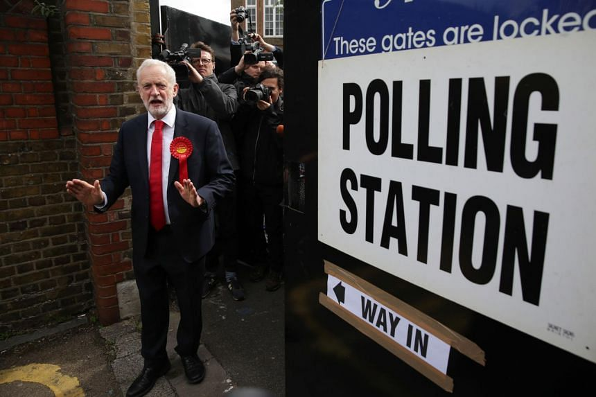 Britain's main opposition Labour Party leader Jeremy Corbyn leaves a polling station after casting his vote in north London, on June 8, 2017.