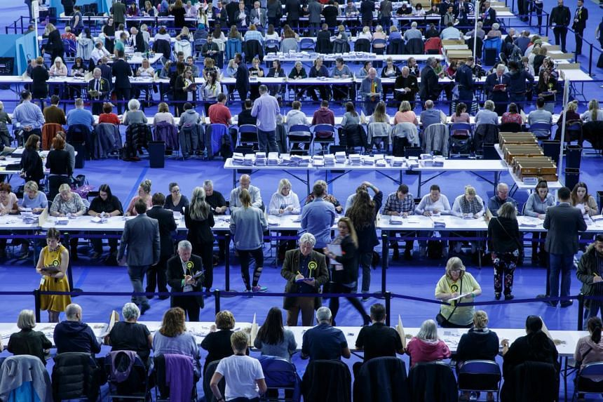 Election officials count votes in the Emirates Arena in Glasgow.