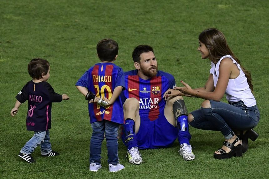 Lionel Messi (centre) speaks with his partner Antonella Roccuzzo (right) past their sons at the end of the Spanish Copa del Rey final football match.