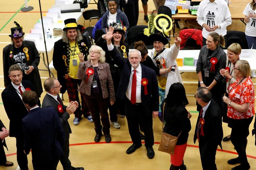 Mr Jeremy Corbyn, leader of Britain's opposition Labour Party, waving as he arrives at a counting centre for Britain's general election in London, June 9, 2017.