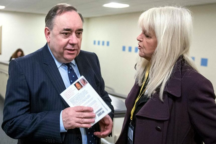 Scottish National Party (SNP) former leader Alex Salmond (left) speaking to a delegate at the Scottish National Party (SNP) Spring Conference, on March 18, 2017.