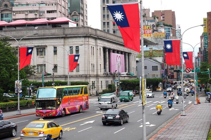 File photo of Taiwan's national flags on lamp posts in Taipei.