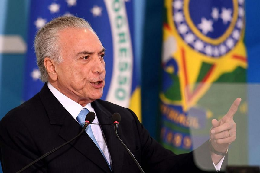 Brazilian President Michel Temer delivers a speech during the inauguration ceremony of the new Minister of Justice, Torquato Jardim at the Planalto Palace in Brasilia, on May 31, 2017.
