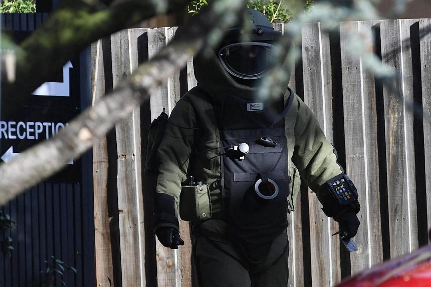 A bomb squad member walks outside the site of a shooting at Buckingham Serviced Apartments in Brighton, Melbourne on June 6, 2017.