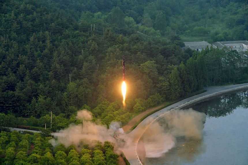 An undated photo released by North Korea's official Korean Central News Agency (KCNA) on May 30, 2017 shows a test-fire of a ballistic missile at an undisclosed location in North Korea.