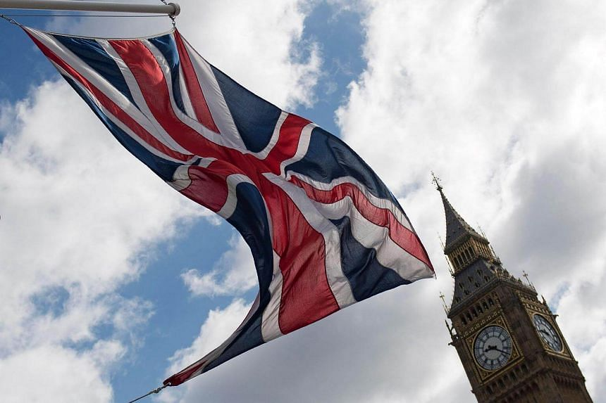 A Union flag flies from a flagpole opposite Big Ben, at the Houses of Parliament in central London.