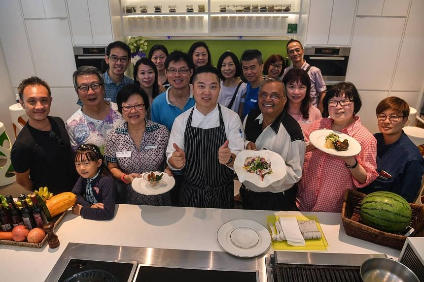 Participants at the farm-to-table event at One Farrer Hotel and Spa pictured with One Farrer Hotel and Spa executive chef Elson Cheong (centre) and Life editor Tan Hsueh Yun (second from right) during a cooking demonstration on June 10, 2017.