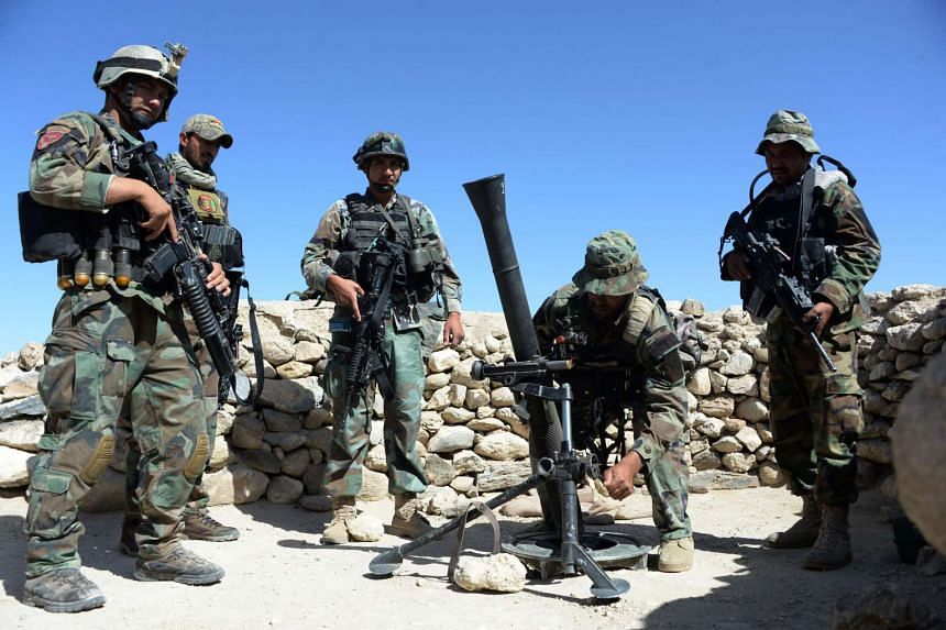 Afghan commandos prepare to launch mortar shells on an ISIS stronghold in April 2017.