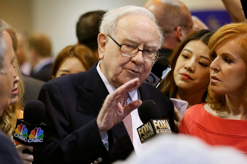 Warren Buffett talks with a reporter before the Berkshire Hathaway annual meeting in May 2017.