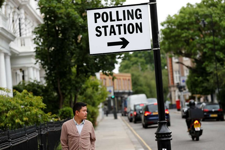 A sign marking a polling station is seen in Kensington, London, Britain on June 8, 2017.