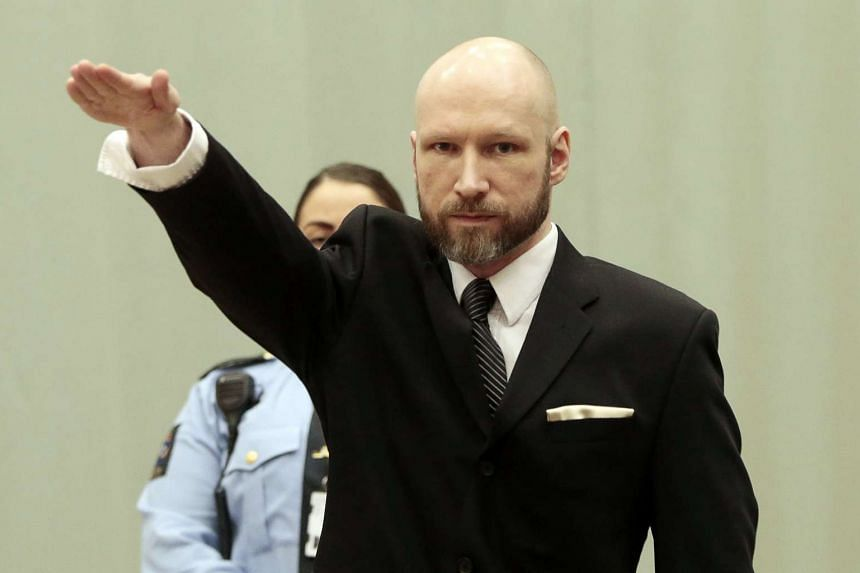 Convicted mass murderer Anders Behring Breivik raises his right arm at his appeal case.