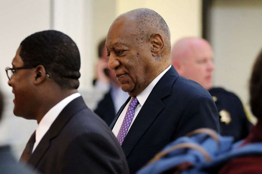 Cosby walks back into the courtroom after a break, June 9, 2017.