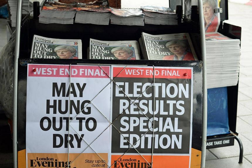 British General election headlines and placards of British newspapers on the news stand at Victoria Station in London, Britain on June 9, 2017.