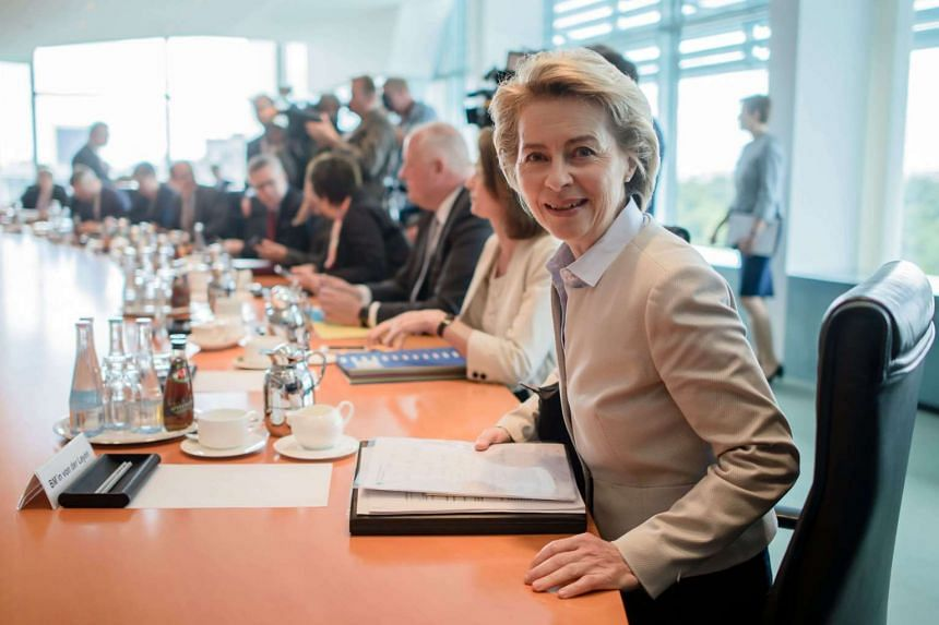 German Defense Minister Ursula von der Leyen takes her seat at the beginning of the weekly meeting of the German Federal cabinet at the Chancellery in Berlin, Germany, on June 7, 2017.