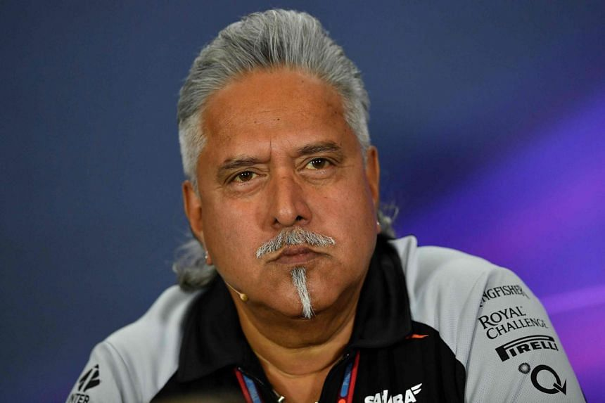 Sahara Force India F1 team principal Vijay Mallya speaking during a press conference at Silverstone motor racing circuit in Silverstone, central England on July 8, 2016.