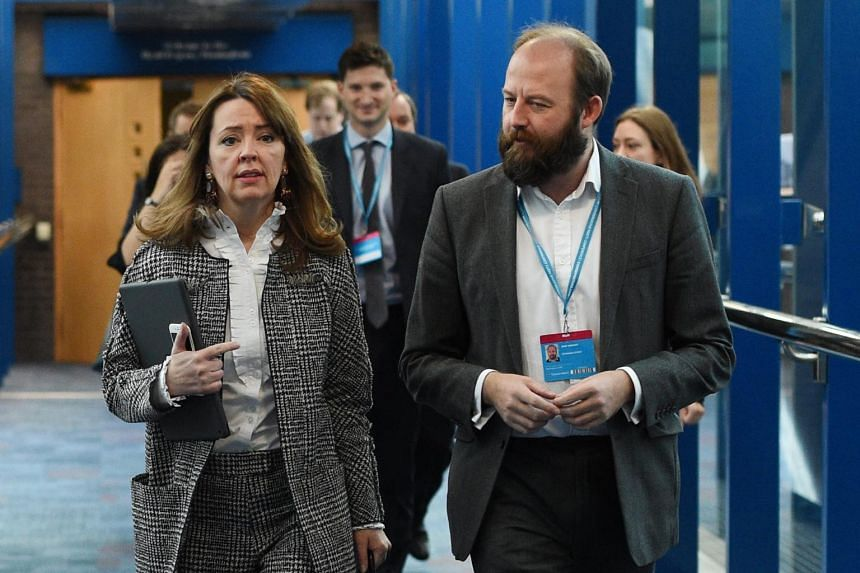 Nick Timothy and Fiona Hill, two of Britain's Prime Minister Theresa May's closest advisers, arrive at the Conservative Party Conference in the International Convention Centre (ICC), Birmingham, central England on Oct 5, 2016.