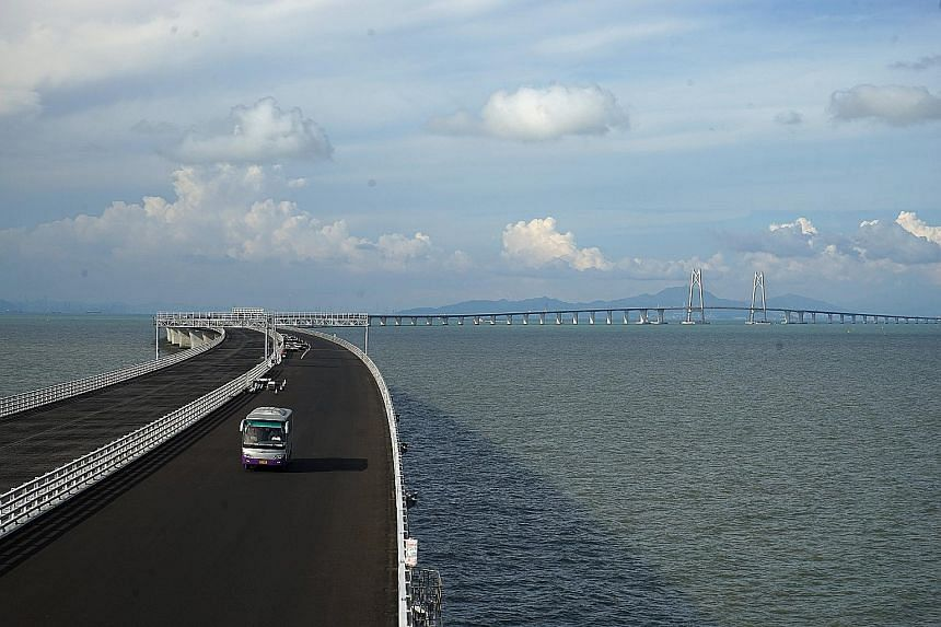 The Hong Kong-Zhuhai-Macau Bridge is one of the biggest infrastructure projects in the Greater Bay Area, estimated to cost US$17 billion (S$23.5 billion). The 55km link consists of a series of tunnels and bridges crossing the Lingding Channel and con