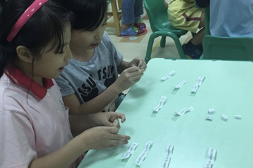 Star Chen (far left) has been attending English cram school since she was three. Now, she goes for classes four times a week after school, spending up to 12 hours a week learning English.